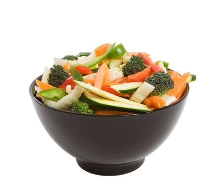 cele: Bowl of freshly sliced vegetables for stir fry isolated over white background