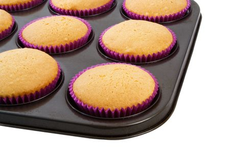 Freshly baked Cup Cakes in oven tray photo