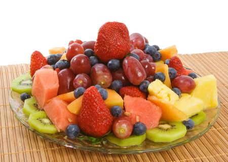 Selection of delicious fresh fruit including strawberries, blueberries, kiwi fruit, pineapple, watermelon, grapes and caneloupe.