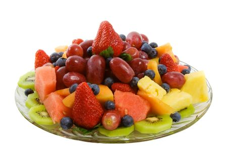 Selection of delicious fresh fruit including strawberries, blueberries, kiwi fruit, pineapple, watermelon, grapes and caneloupe. photo