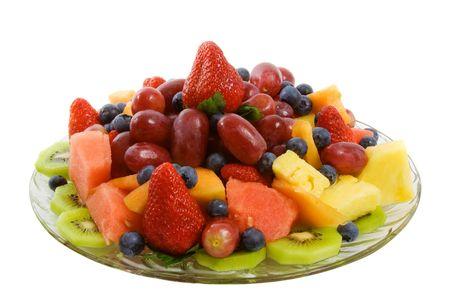 Selezione di deliziosa frutta fresca tra le fragole, mirtilli, kiwi, ananas, anguria, uva e caneloupe.