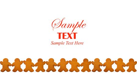 Bottom border of Gingerbread Men holding hands over white background with copy space for text. Stock Photo