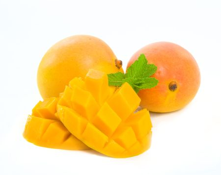 Delicious ripe Mango sliced ready for eating.  Isolated over white background