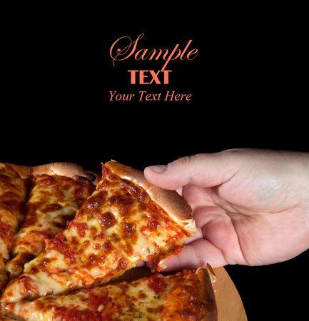 Whole Margharita Pizza over black background Stock Photo