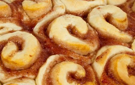 A batch of fresh Jam Scrolls baked golden brown Stock Photo