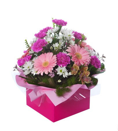 boxed: Beautiful pink themed floral arrangement in presentation box isolated over white background.