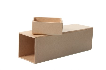 Open cardboard box laying on its side with separate lid sitting on top, isolated over white background.