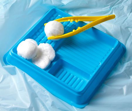 Sterile wound care kit with tweezers, cotton balls and gauze.