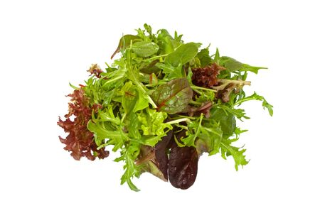 Selection of fresh mixed green salad leaves over white background