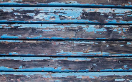 Old weatherboards with flaking blue paint. Stock Photo