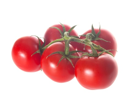Ripe red trusse tomatoes isolated over a white background Stock Photo