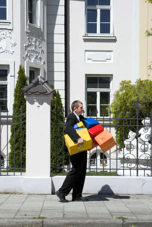man with many birthday gifts photo