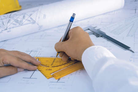 architect draws a blueprint photo