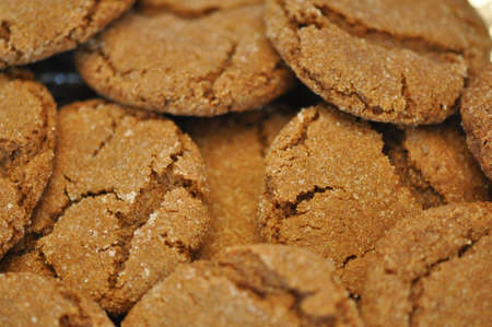 a closeup of a group of gingersnap cookies