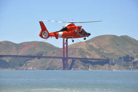 Rescue helicopter and the San Francisco Bridge Stock Photo