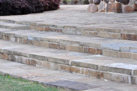 A wide natural stone stairway outdoors
