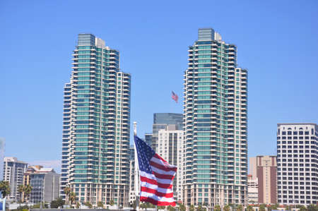 View of the San Diego Skyline with an american flag flying in the middle