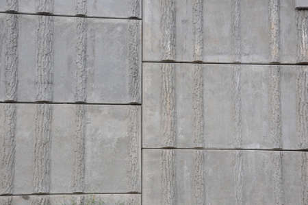 A pattern of concrete gray squares wall Stock Photo