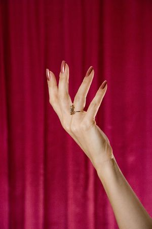 Hand of the woman on a claret background