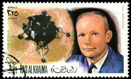 a stamp printed by  RAS AL KHAIMA  shows  Neil Armstrong - first man on the Moon, circa 1969.  photo