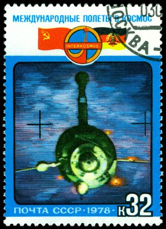 frac12: a stamp printed by USSR  shows flight of the joint crew USSR &iuml,&iquest,&frac12, DDR  in space, series, circa 1978.