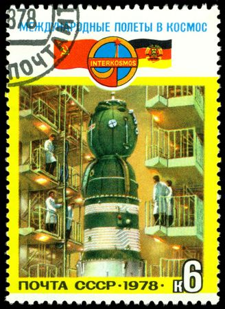 iquest: a stamp printed by USSR, shows preparing the flight of the joint crew USSR &iuml,&iquest,&frac12, DDR  in space, series, circa 1978.