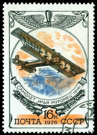 USSR - CIRCA 1976: A stamp printed in the USSR shows  old plane  photo