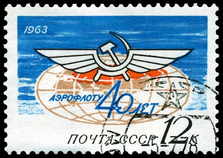USSR - CIRCA 1963: A stamp printed in the USSR shows wing - symbol to aviations, circa 1963 photo