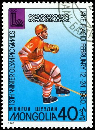 poststempel: Mongolei - CIRCA 1980 ein Stempel von der Mongolei gedruckt, zeigt Eishockeyspieler 13 Winterspiele im Lake Placid USA um 1980 Editorial