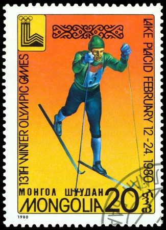 Mongolia- CIRCA 1980: a stamp printed by Mongolia, shows skier. 13 Winter Olympic games in  Lake Placid. USA. circa 1980