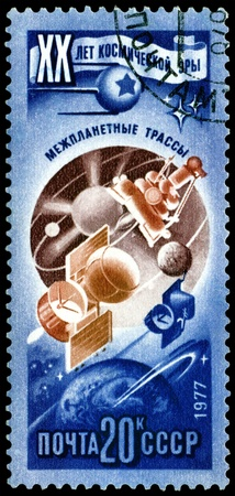 interplanetary: USSR - CIRCA 1977: a stamp printed by  USSR  shows  interplanetary routes. 20 years of a space age.  Series, circa 1977 Stock Photo