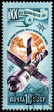 space age: USSR - CIRCA 1977: a stamp printed by  USSR  shows  orbital station. 20 years of a space age.  Series, circa 1977
