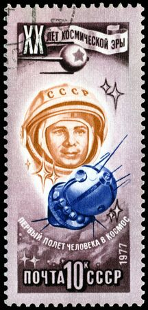 space age: USSR - CIRCA 1977: a stamp printed by  USSR  shows  the first  cosmonaut  Jury Gagarin. 20 years of a space age.  Series, circa 1977