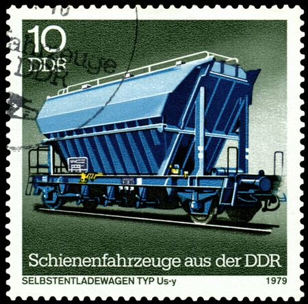 unloading: GDR - CIRCA 1979: A Stamp printed in the GDR  shows unloading freight car Us-y, circa 1979