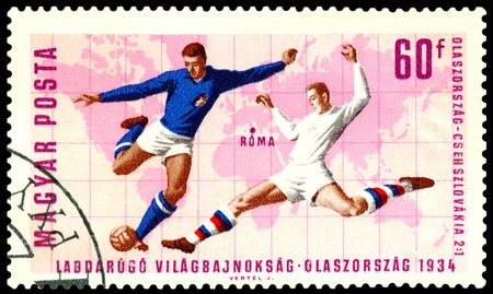 Hungary - CIRCA 1966: a stamp printed by Hungary shows soccer player Italy and Chechoslovaria . World  football cup in Roma 1934, circa 1966 photo