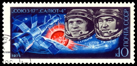 USSR - CIRCA 1975  A post stamp printed in USSR shows russian astronauts  A A  Gubarev and G M  Grechko aboard Soyuz 17     orbital station Salyut 4   Circa 1975  photo