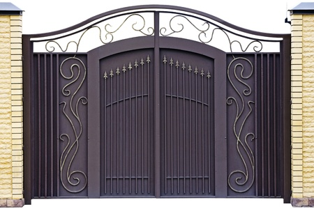 Modern  forged  decorative  gates.  Isolated over white background. photo