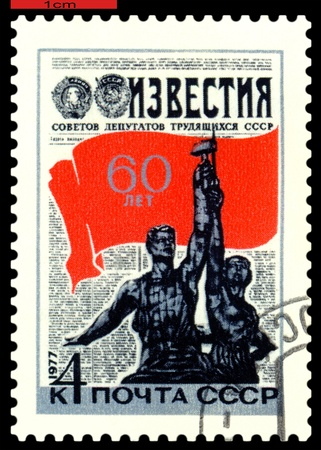 USSR - CIRCA 1977: a stamp printed by USSR , shows  Worker and Farmer  Monument,  60 th anniv. newspaper Notify,  circa 1977 photo