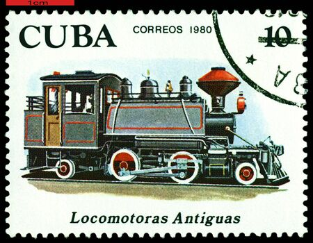 Cuba - CIRCA 1980: A Stamp printed in the  Cuba  shows  antique locomotive 2-4-2, series, circa 1980 photo