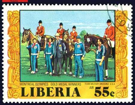 LIBERIA - CIRCA 1977: a stamp printed  by  Liberia, shows Gold medal Winners USA. Olympic games in Montreal, circa 1976 Canada photo