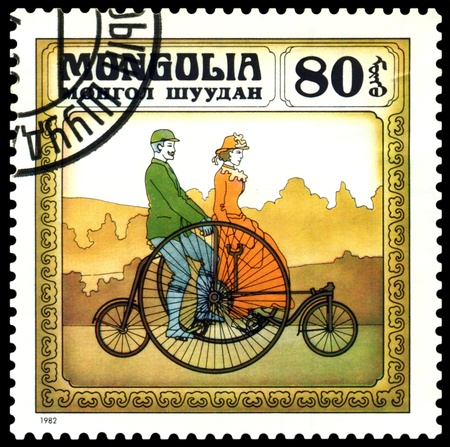 MONGOLIA - CIRCA 1982: A stamp  printed  in Mongolia shows  old-time  England bicycle  1870,  series  Historic  bicycle,  circa 1982  Stock Photo