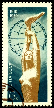USSR - CIRCA 1970: a stamp printed by USSR shows woman with a torch - a symbol of March 8 - International Womens Day of Solidarity, circa 1970 photo