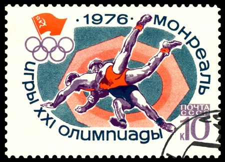USSR - CIRCA 1976: a stamp printed by USSR shows  Greco - Roman wrestling,  Olympic games in Montreal, Canada, circa 1976 Stock Photo - 11102756