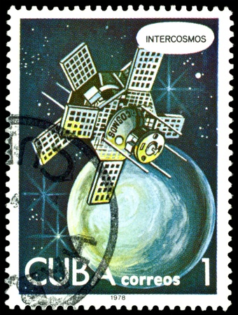 CUBA - CIRCA 1978: a stamp printed by Cuba  shows satellite Interkosmos  in space, series Astronautics day, circa 1978. photo