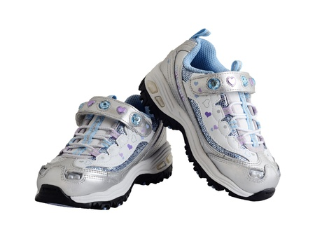 Sneakers - a Suitable footwear for  girls. Gift on Christmas. On white background. Stock Photo