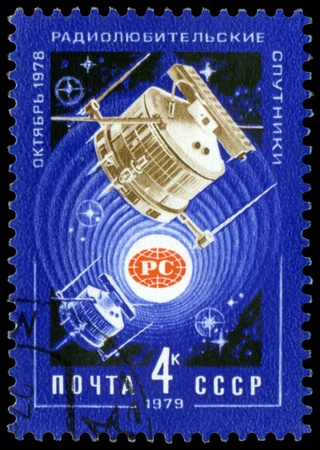 USSR - CIRCA 1979: a stamp printed by USSR  shows  Satallites Radio 1 and Radio 2 in space, circa 1979. photo