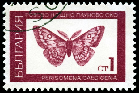 BULGARIA - CIRCA 1968: A stamp printed  by  Bulgaria  shows  butterfly  Saturnid moth ( Perisomena Caecigena. L), series beetle, circa 1968  photo