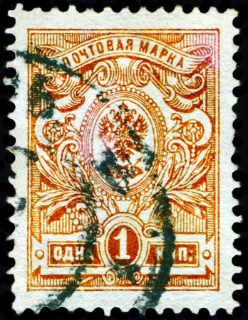 RUSSIA - CIRCA 1909: a stamp printed by Russia, shows Blazon to Russian empire, series, circa 1909 photo