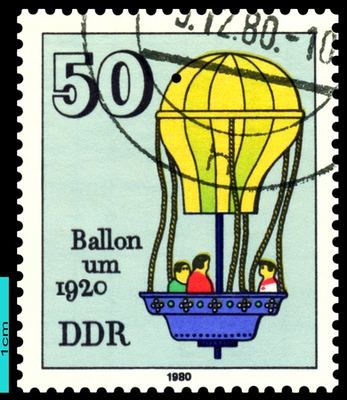 GDR - CIRCA 1980: a stamp printed by GDR , shows  air-balloon, 1920, circa 1980 photo