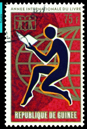 guinee: REPUBLIQUE  DE GUINEE - CIRCA 1972: A Stamp printed in the  Republique de Guinee shows  Children, Book , Youth and Globe,  series, circa 1972 Stock Photo
